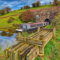 Barge emerging from the tunnel on the Leek branch of the Caldon Canal by Mark Pointon